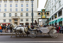 VIENNA, AUSTRIA - DECEMBER 28, 2016: Fiaker Horse Carriage Near Ankeruhr Clock In Hoher Markt On December 28, 2016 In Vienna Austria