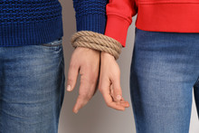 Couple With Tied Together Hand...