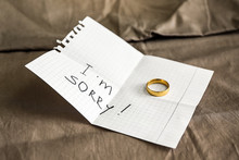Paper Sheet With Text I'M SORRY And Ring On Cloth. Concept Of Divorce