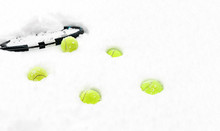 Tennis Balls And Racket On Whi...
