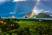 A Rainbow Appears Over The Island Of Phuket. This Ocean Of India Tropical Island Is One Of The Most Beautiful In The World.