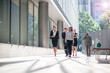 Businesspeople walking in city