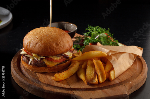 Big tasty burger and fries on the table