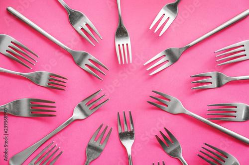 Set of forks on color background - 239368960