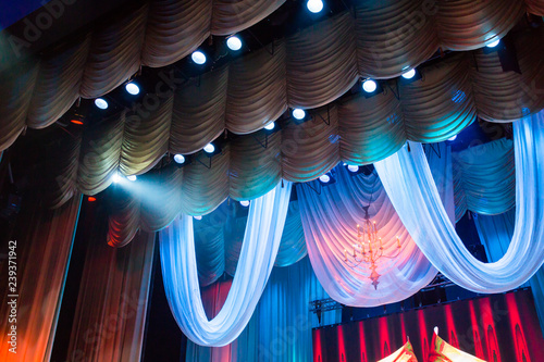 Lighting equipment and scenery in the theater on stage.