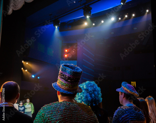 Actors on stage during a performance or rehearsal in the theater. The stage of the theatre or the Opera, with lighting equipment. Light and spotlight on the stage.
