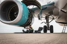 Man Working On Airplane Engine...