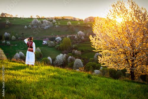 Fototapety Muzyka traditional-slovak-folk-dress-spring-landscape