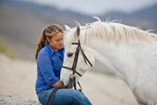Young Woman With A White Horse...