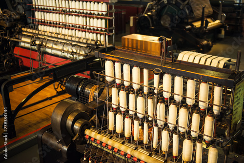 Valokuva Rows of white cotton threads on vintage automatic loom