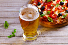 Glass Of Beer And Pizza On Wooden Table. Beer And Food Concept. Ale.