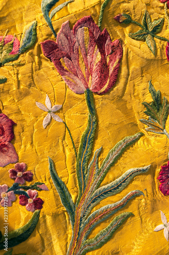 Fotografie, Obraz  I have owned this a piece of gold coloured silk fabric embroidered with  flowers for 30 years