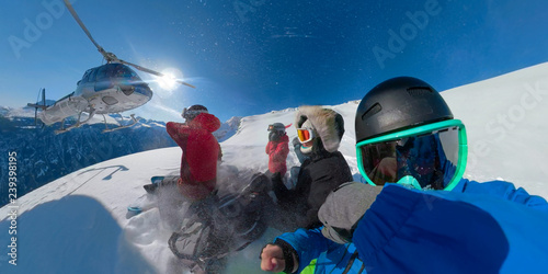 Acrylic Prints Winter sports SELFIE: Group of extreme snowboarders waiting for the helicopter to pick them up