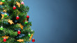 canvas print picture Christmas tree part with decorations, blue background