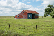 Texas Flag Painted On Old Barn