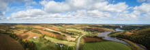 Aerial Panoramic Landscape View Of Farm Fields During A Sunny Day. Taken Near New Glasgow, Prince Edward Island, Canada.