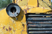 Grille And Headlamp Socket On Wrecked Yellow Truck