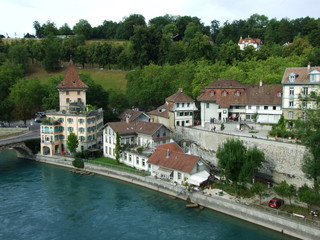 Fototapeta na wymiar Panoramic view of the roofs of houses along the river Aare in the center of Bern - the capital of the Swiss Confederation