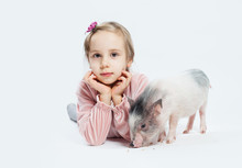 Cute Little Girl With Pig. Child And Pet