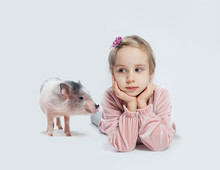 Little Friends. Cheerful Child Girl And Pig On White Background