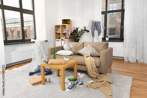 Fototapeta mess, disorder and interior concept - view of messy home living room with scatte