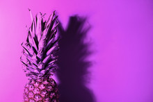 Ripe Pineapple On Color Backgr...