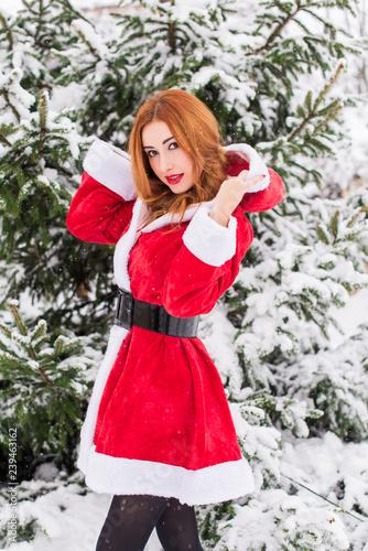 Christmas Babes.Merry Christmas And Happy Holidays Santa Girl At Snowy Day