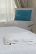 two white towels on the bed in the hotel