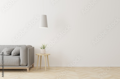 Obraz na plátně Interior of living room modern style with grey fabric sofa,wooden side table and white ceiling lamp on wooden floor