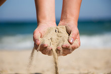 Hand Holding Sand. Hand With S...