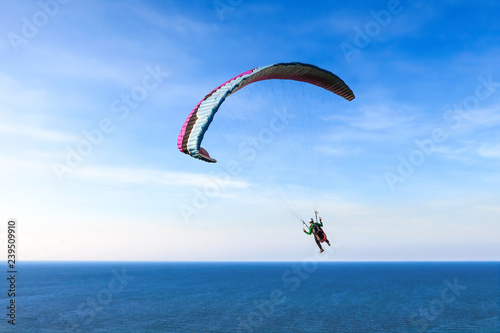 Parachute on sky and sea background