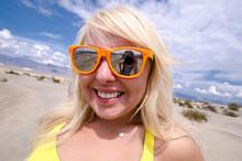Blonde Female Wearing Beach Su...