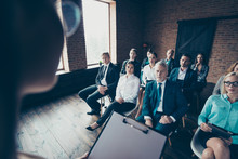 Close Up Photo Of Work People Attentive Seriously Looking To Boss Assistant Noticing Who Absent And Present At Gathering Team Building All Weared In Formal Wear Jackets Shirts