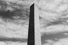 Detail Of Tall Brick Chimney Extending Towards Cloudy Sky