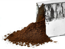 Poured Ground Coffee With Opened Coffee Pouch Isolated On White Background