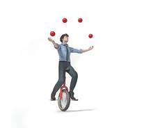 Juggler Is Balancing On Bike.