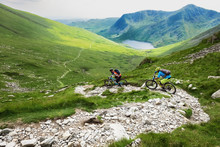 Mountain Bikers Descending Fas...