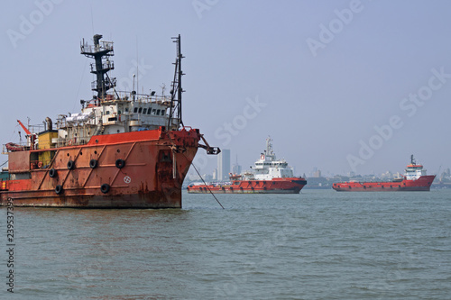 Commercial shipping at anchor in the Arabian Sea off the coast of Mumbai which is the busiest port in South Asia