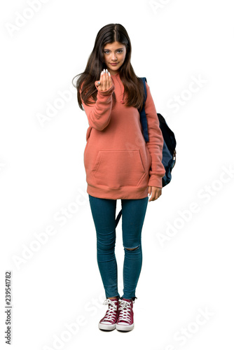 Photo  A full-length shot of a Teenager girl with sweatshirt and backpack inviting to come with hand