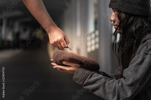 Fotografie, Obraz  Beggars, Homeless people sitting on the floor, Discouraged and desperate, ask for a fraction of money from people travelng to buy food to live, to homeless concept