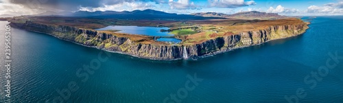Fototapeta Aerial view of the dramatic coastline at the cliffs by Staffin with the famous Kilt Rock waterfall - Isle of Skye - Scotland obraz