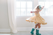 Young Girl Twirling In Her Dress