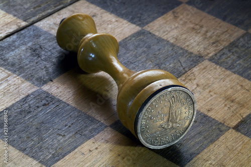 Chess King with a 1 Dollar Coin on a Chess Board - Buy this