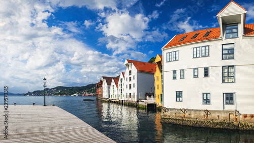 City on the water Historical buildings in Bryggen - Hanseatic wharf in Bergen, Norway. Scenic summer panorama with the Old Town pier architecture and large cruise ship in the port