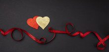 Top View Of Red And Golden Hearts With Ribbon, Black Background, Isolated, Banner.