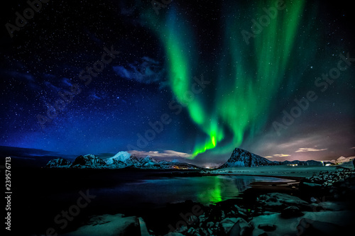 Wall Murals Northern lights Aurora Borealis. The green Lady