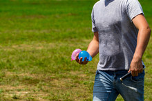 Colorful Water Bombs In Summer Ready To Play.  Holding Balloons In Hand