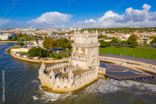 Door stickers Fortification Aerial drone panorama photo of the Belem Tower (Belém Tower) at sunset. A medieval castle fortification on the Tagus river of Lisbon Portugal