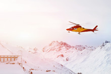 Rescue Helicopter Landing On Slopes At Ski Resort In Alpine Mountains. Emergency Accident Service