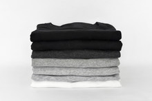 Stack Of Folded Black, Grey An...
